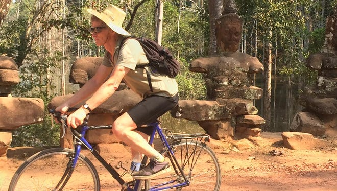 Rod bikes in sweltering heat near Angkor Wat, Cambodia.