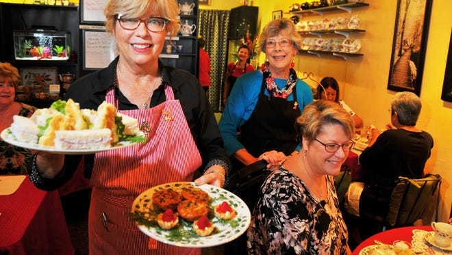 One of the best kept secrets of Titusville is Tea World Café & Tea Room in a small strip mall across from SearsTown Mall on Hopkins Ave. Hostess Ronni Skirko brings out a plate of tea sandwiches. In the background is tea consultant Donna Masters.