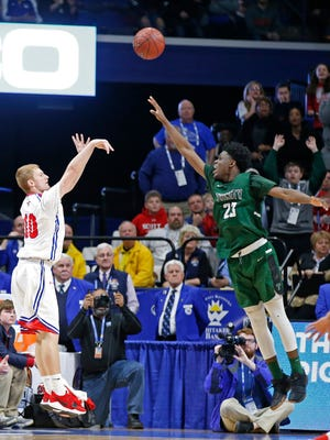Scott County's Cooper Robb, 10, left, puts up the eventual game winning three point bast over Trinity's Jamil Hardaway, 23, during a first round game of the Whitaker Bank/KHSAA Boys' Sweet 16 basketball tournament played at Rupp Arena in Lexington, Ky. Wednesday March 14, 2018. (Photo by Gary Landers)