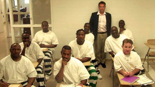 Inmates writing at the Mississippi State Penitentiary