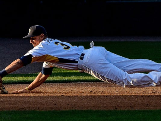 York Revolution third baseman Bryan Pounds makes a diving grab on a grounder hit down the line by Lancaster's Henry Wrigley on Monday.