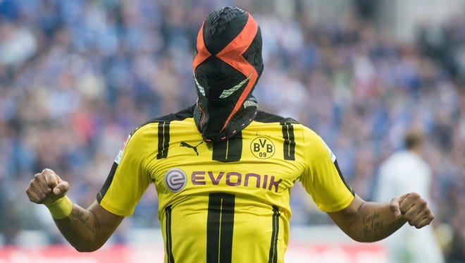 Pierre-Emerick Aubameyang from Dortmund celebrates with a mask after scoring  during the German Bundesliga soccer match between FC Schalke 04 and Borussia Dortmund.