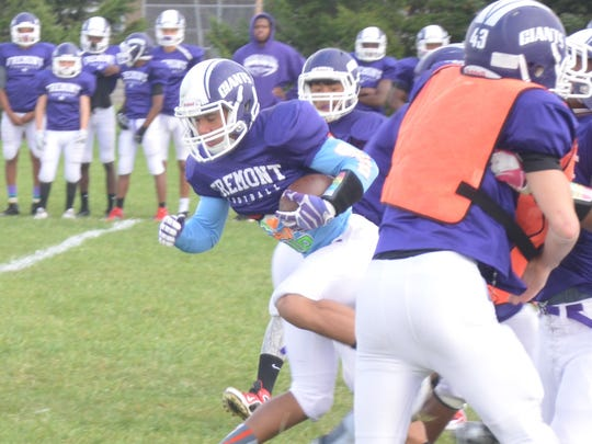 Fremont Ross junior Tyler Grine returns a kickoff through a crowd during practice Wednesday afternoon. The Little Giants will host Toledo Central Catholic at 7 p.m. Friday at Don Paul Stadium.