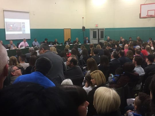 Audience members crowd into Tuesday's meeting of Cherry Hill's school board.