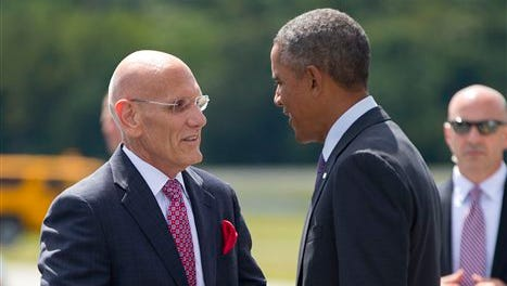 President Barack Obama is greeted by Ron Belmont, left, Mayor of Harrison, NY., on the tarmac upon his arrival at Westchester County Airport, in White Plains, NY., Friday, Aug. 29, 2014. Obama is traveling to New York and Rhode Island to attend a pair of private Democratic fundraisers before returning to Washington later tonight.