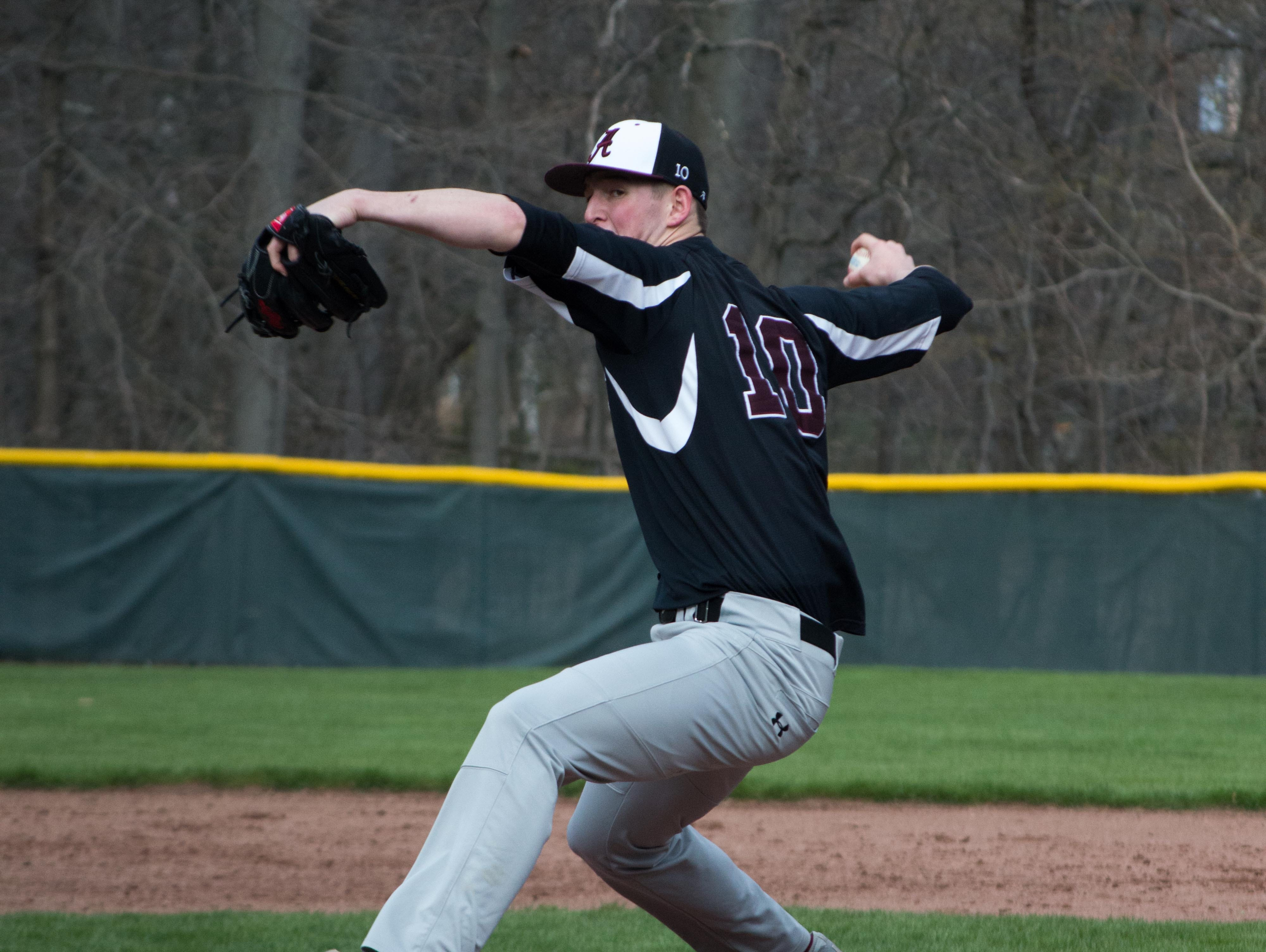 Albertus Magnus pitcher James Reilly works in the first inning of a game against Rye at Disbrow Park in Rye on April 8, 2016.