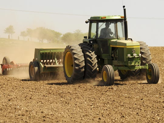 Tractor working a field.