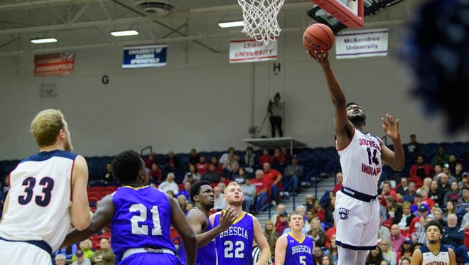 USI's Emmanuel Little (14) makes a layup as his team plays the Brescia Bearcats at USI's Physical Activities Center in Evansville, Ind., Tuesday, Nov. 14, 2017. The Screaming Eagles defeated the Bearcats, 93-67.