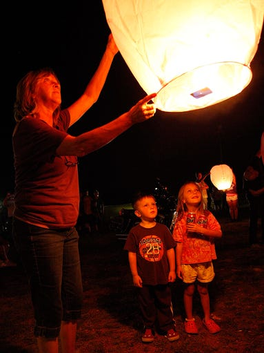 Mason and Kaelin Edwards watch as their grandmother Sherrie Mason releases a lanturn in honor of Hailey Owens during a birthday celebration for Hailey at the American Legion Post 639 in Springfield on August 18, 2014.