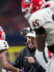 Georgia head coach Kirby Smart celebrates after a late touchdown against Auburn in the SEC Championship Game at Mercedes-Benz Stadium in Atlanta, Ga. on Saturday December 2, 2017. (Mickey Welsh / Montgomery Advertiser)