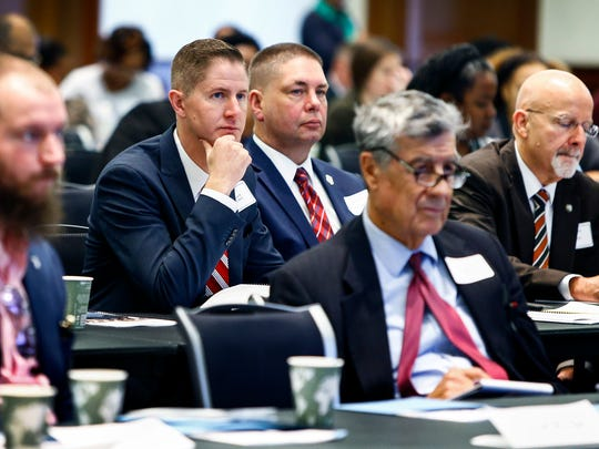 Audience members listen to speakers during the Breaking the Cycle of Delinquency Symposium - A Discussion of the Juvenile Assessment CenterConcept for Memphis and Shelby County at the University of Memphis Tuesday, Oct. 17, 2017.