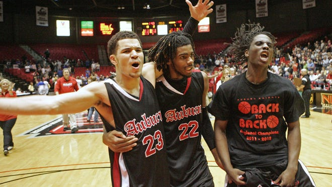 Auburn's Fred VanVleet (23), LaMark Foote (22) and Elijah Smith (5) celebrate after beating Gurnee Warren in the 2012 Class 4A Supersectional.