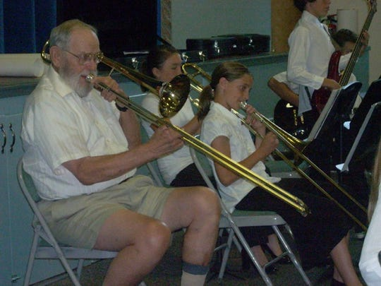 John Lawson plays the trombone with the North Cow Creek School Jazz Band for his 80th birthday in 2007.