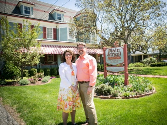 The Crystal Champagne Bucket of Flemington's Main Street Manor Bed & Breakfast to new owners Tim and Marissa Bebout stand outside their recently purchased Main Street Manor Bed & Breakfast in downtown Flemington.
