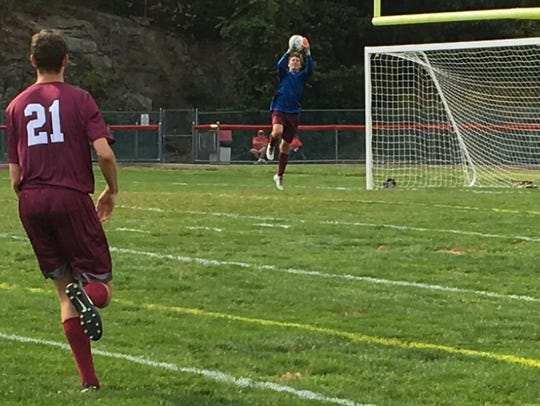 Verona junior goalie Robert Parent grabs a shot in