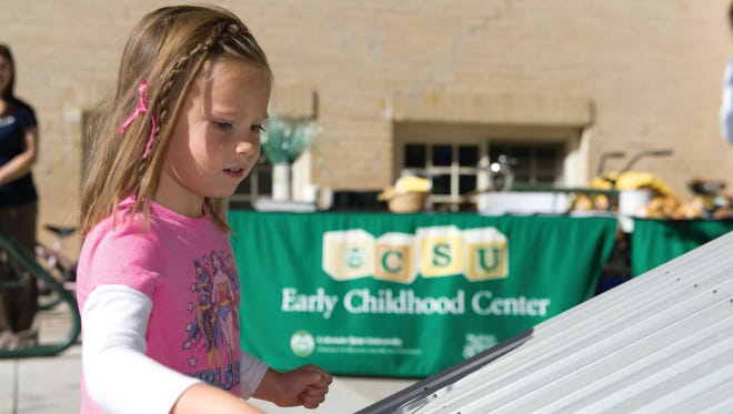 The new outdoor musical instruments are a hit with the preschoolers at the CSU Early Childhood Center.