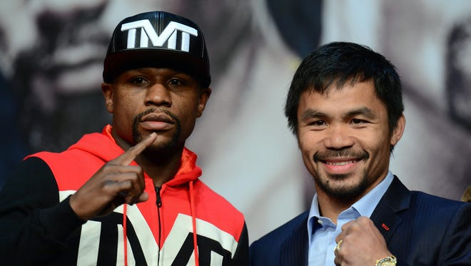 Floyd Mayweather and Manny Pacquiao pose for a photo during a press conference at KA Theatre.
