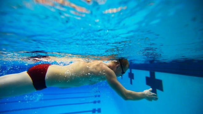 Chris Doemland swims laps at the Central York High School pool. Doemland swam competitively in high school and college, but as work and family demands increased, his fitness slowly decreased. Returning to the pool is like coming home for him, he said.