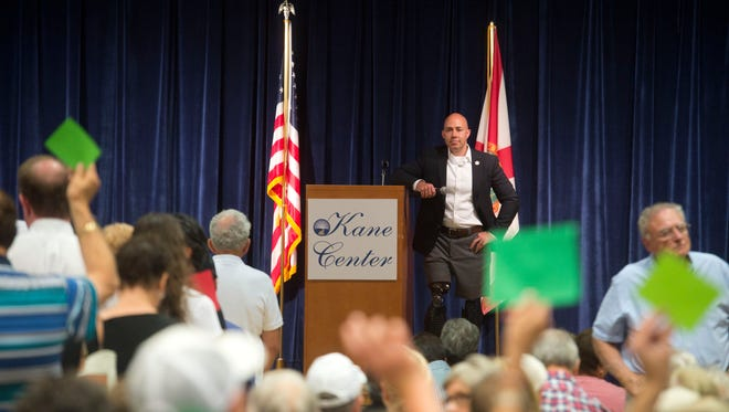 U.S. Rep. Brian Mast at a town hall discussion with more than 400 constituents at the Kane Center in Stuart in June.