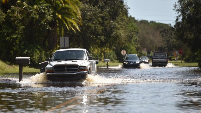 Flooded streets are still a problem for many in Lakewood Park as traffic moves slowly along Winter Garden Parkway east of Fort Pierce Boulevard on Tuesday, Sept. 12, 2017, in the aftermath of Hurricane Irma.