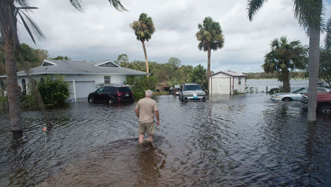 """This is enough to shake your faith,"" said Lon Parsons, of Fort Pierce, after 10 inches of rain flooded his property during Hurricane Irma, seen Monday, Sept. 11, 2017, on Edwards Road in Fort Pierce. Parsons, his wife Anna Parsons, and their three dogs rode out the storm as their yard and garage filled with water."