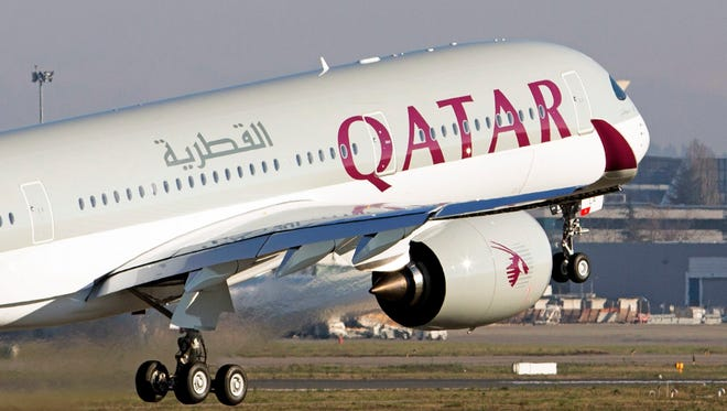 This file photo from Dec. 22, 2014, shows an Airbus A350 XWB taking off during a delivery ceremony to Qatar Airways in France.