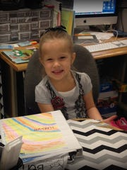 Sonoma Elementary first grader Harlyn Radley was an avid reader and dancer who died last month after a crash on M-66. Here, she enjoys being Teacher for the Day.
