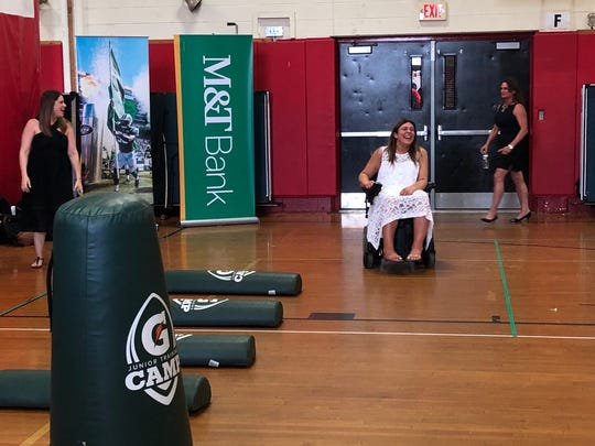Bergenfield High School guidance counselor Lauren LaPorta arrives at a surprise ceremony honoring her on Tuesday. The Jets named LaPorta the winner of the M&T Bank Touchdown for Teachers program.