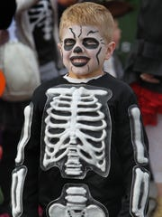 Grant Blake, 4, Noblesville, dressed as a skeleton to trick-or-treat at Clay Terrace in Carmel  in 2013.
