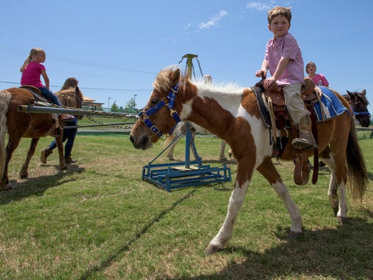 Pony rides at the Wags 4 Wishes fundraiser at Taylor Crossing Animal Hospital in Montgomery, Ala. on Sunday April 10, 2016.