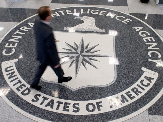 This Aug. 14, 2008, file photo shows a man crossing the CIA logo in the lobby of CIA headquarters in Langley, Va.