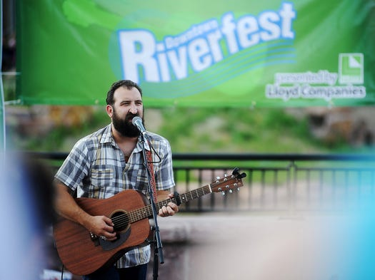 Thomas Hentges, of Burlap Wolf Kings, performs on the Great Western Bank Amphitheater Main Stage during the second annual Downtown Riverfest on Saturday, Aug. 16, 2014, at the Downtown River Greenway along the Big Sioux River in Sioux Falls, S.D.