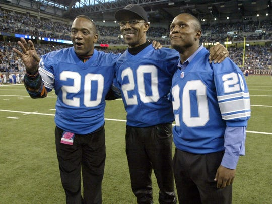Former Detroit Lions stars Billy Sims, left, Lem Barney, center, and Barry Sanders before the Lions game with the Indianapolis Colts in Detroit on Thursday, Nov. 25, 2004.