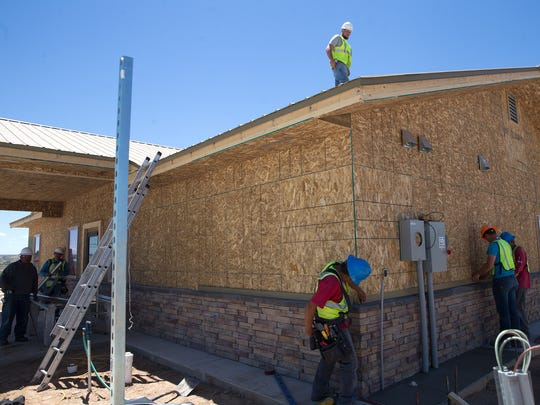 Construction workers were busy Wednesday as the Kirtland Town Hall moves closer to completion.