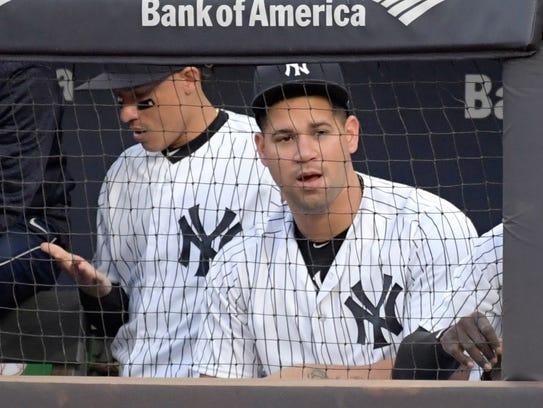 New York Yankees catcher Gary Sanchez watches from