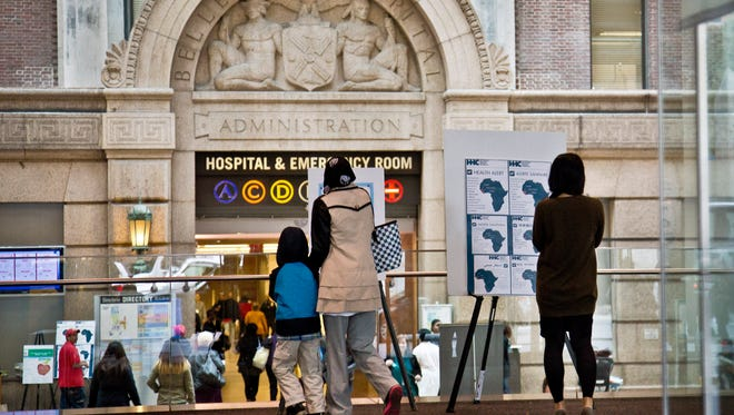 Health alerts are posted for travelers to particular West African countries at the main lobby entrance of Bellevue Hospital in New York.