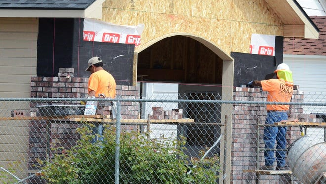 """Bricklayers work earlier this month on the exterior of the new """"Station #3"""" being constructed at the Lyon County Museum to house antique firefighting and EMS apparatus and equipment. It will be open to the public at the museum open house June 27."""