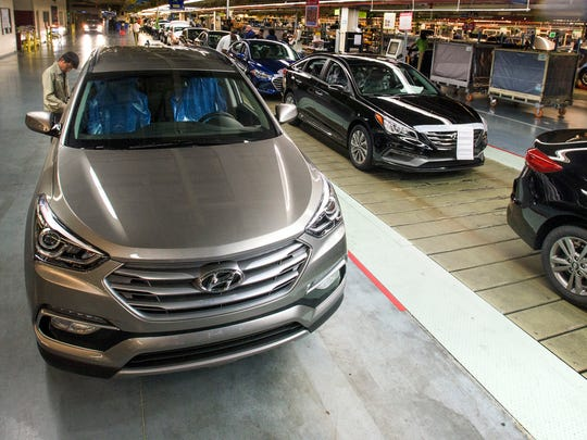 A Hyundai Santa Fe is checked for fit and finish after it comes off of the line at Hyundai Motor Manufacturing Alabama in Montgomery, Ala., on Thursday June 2, 2016.