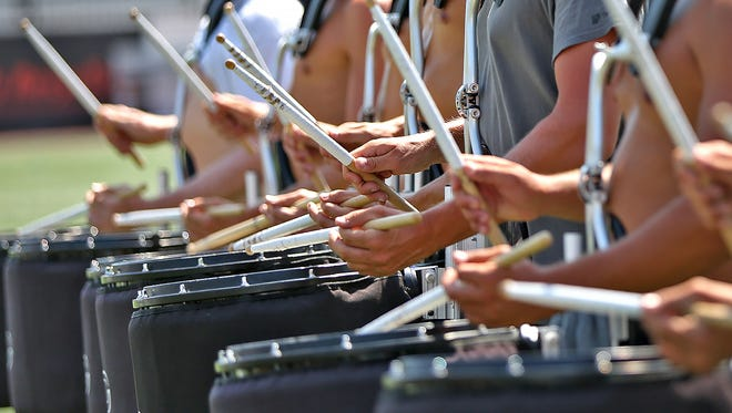 A drum line practices at IUPUI's Carroll Stadium, Thursday, Aug. 10, 2017, getting ready for the Drum Corps International's World Championships.