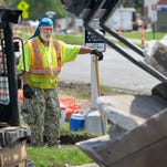 Loren Hendrickson, a construction worker for Hardrives, wears a cooling wrap in the heat Wednesday afternoon, July 20, 2016, as his crew removes the old concrete from a crosswalk on the Northway Drive project. Hendrickson says the cool wrap helps but the crew also takes more breaks and carries more water on hot days.