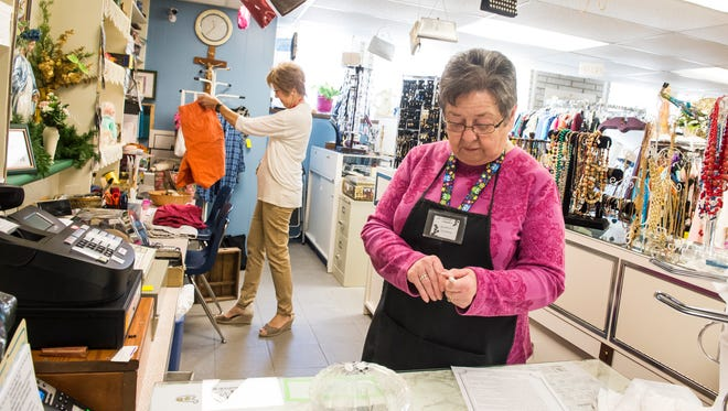 Volunteers Caroline Murren, right, and Ann Traynham work at St. Vincent's Thrift Shop in Hanover Borough on May 7, 2018. The thrift shop, located at the rear of 224 Third Street, is open Monday through Saturday from 10 a.m. to 2 p.m.