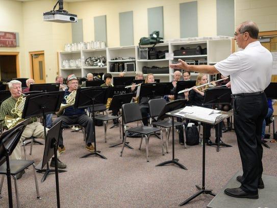 Novi Concert Band director Diran Kochyan conducts during