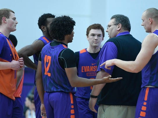 University of Evansville coach Marty Simmons talks to his team during a inter-squad scrimmage at the HoopFest season tipoff for the men's and women's basketball programs at the Meeks Family Fieldhouse on Wednesday.
