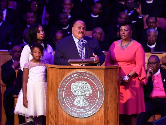 "Martin Luther King III speaks as he is flanked by his daughter Yolanda and wife Andrea (lt) and his sister Dr. Bernice King during the Mountaintop speech commemoration at the Mason Temple of the Church of God in Christ Tuesday, April 3, 2018, in Memphis, Tenn. The church is where Rev. Martin Luther King Jr. delivered his final speech, which contained the phrase, ""I've been to the mountaintop,"" on April 3, 1968, the night before he was assassinated. Seven demonstrators were arrested during the protest."
