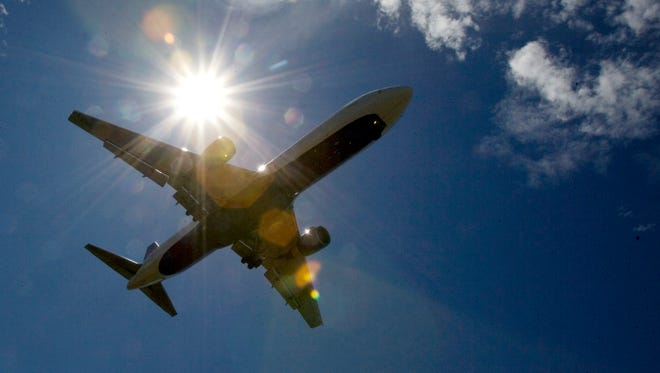 This file photo from July 20, 2009, shows a plane headed to Oregon's Portland International Airport in Portland.