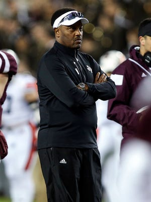 Texas A&M Aggies head coach Kevin Sumlin watches during warm ups before a game against the Auburn Tigers at Kyle Field.