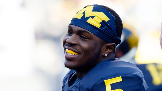 Apr 1, 2016; Ann Arbor, MI, USA; Michigan Wolverines saftey Jabrill Peppers (5) smiles during warm ups before the Spring Game at Michigan Stadium.
