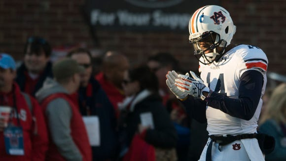 Auburn quarterback Nick Marshall (14) will lead the Tigers into Tuscaloosa for Saturday night's Iron Bowl against rival Alabama.