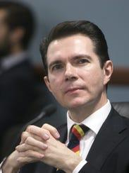 Arizona Corporation Commissioner Bob Stump looks on