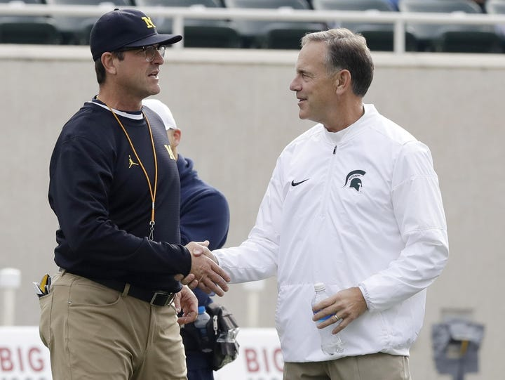 Michigan head coach Jim Harbaugh, left, is ranked No.
